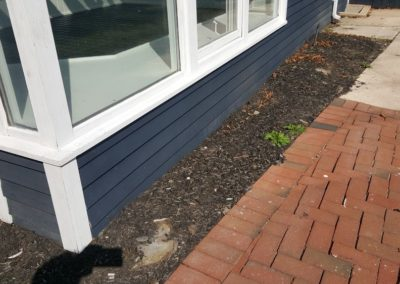 SIDING SHOULD BE FEW INCHES ABOVE SOIL. TO PREVENT ROT DAMAGE, MOVE SOIL AWAY FROM WOOD SIDING.
