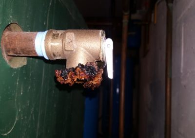 LEAKING SAFETY PRESSURE VALVE. INSTALL EXTENSION VALVE. CORROSION DUE TO LEAKING OVER TIME.