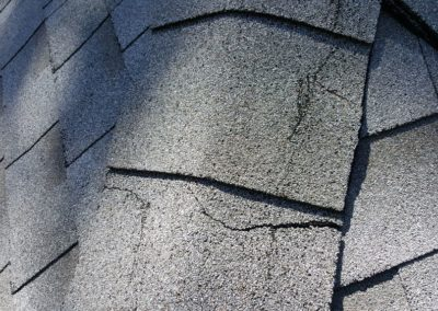 Compromised roof shiungles, cracks and brittle all around. Recomanded replacement soon.